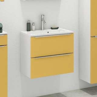 Waschbeckenschrank in Gelb und Weiß hängend