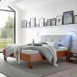 Design Holzbett in Kirschbaumfarben Buche massiv gepolstertem Kopfteil in Hellgrau